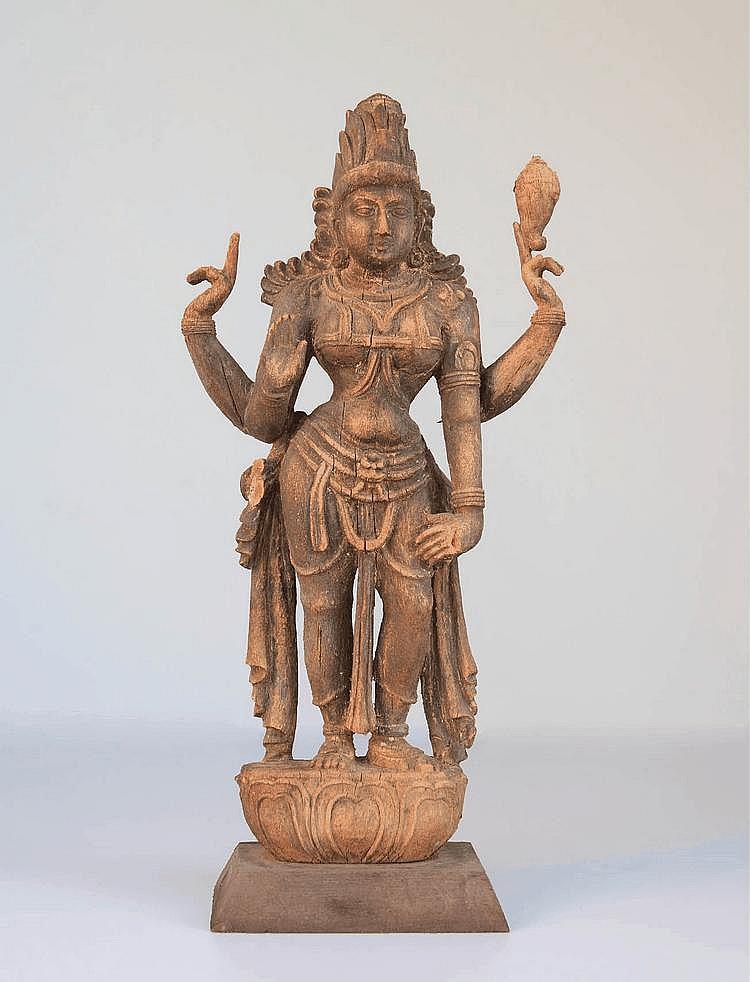 A fine wooden statue of a standing goddess Lakshmi