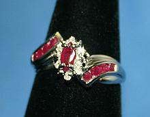 10KW Gold Ruby & Diamond Ring. The ring features