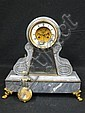GRAY MARBLE MANTLE CLOCK: The enamel dial with gilt mounts, gilt front paw feet.
