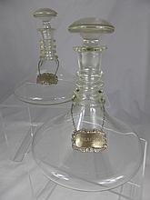 A Pair of Antique Clear Glass Ships Decanters and