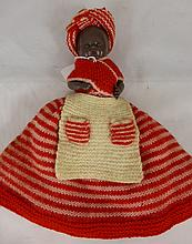 Vintage coloured tea cosy in the form of a doll