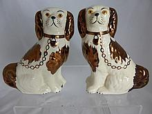 Pair of ceramic flat back figures of spaniels by