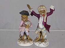 Two continental porcelain figures of monkeys, one