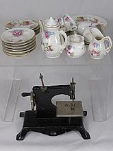 A Porcelain Doll's Tea Set depicting Flowers, toge