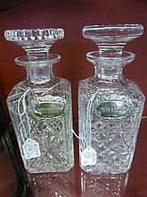 A Pair of Heavy Cut Glass Decanters, with two soli
