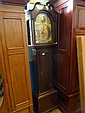 An oak cased antique grandfather clock, the clock