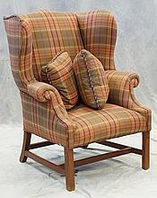 American upholstered wing armchair, 19th Century, on square legs and stretchers, 42