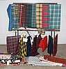 Plaid lot to include Canadian territory plaids of various lengths and sizes, plaid materials from various families, blankets and bed...