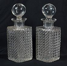 Pair of cut crystal decanters; minor roughness to bottoms of both, approximately 9