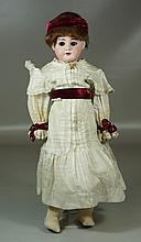 AM & DEP German 19th Century doll, mold # 1894, with porcelain head, wig, sleepy eyes and delineated teeth and composition body. 18