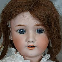 Heinrich Handwerck bisque head child doll, mold 129; original wig, sleep eyes, open mouth, pierced ears, composition ball jointed bo...
