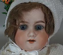 Armand Marseille doll, with ceramic head and shoulders and leather body, sleep eyes and mouth with delineated teeth, marked