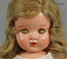 Composition doll with sleep eyes and teeth delineated, 23