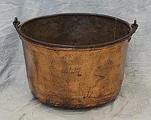 Copper apple butter kettle, dents, wrought iron handle, 25 3/4
