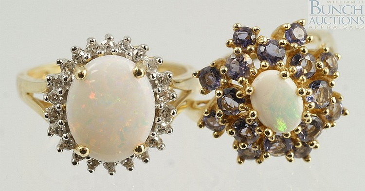 (2) 14K YG opal rings, 1 w/22 small 2 pt +/- diamonds surrounding an 11 x 8 mm opal, size 7, the other with amethyst colored stones ...