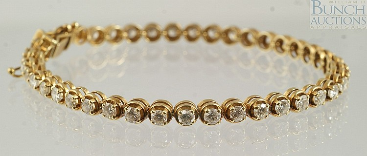 14K YG diamond tennis bracelet, 41 diamonds about 10-15 pts each, 7