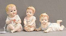Three Early Porcelain Piano Babies