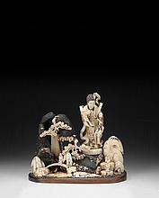 A JAPANESE CARVED IVORY FIGURAL GROUP