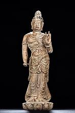 A STONE CARVED STANDING BODHISATTVA FIGURE