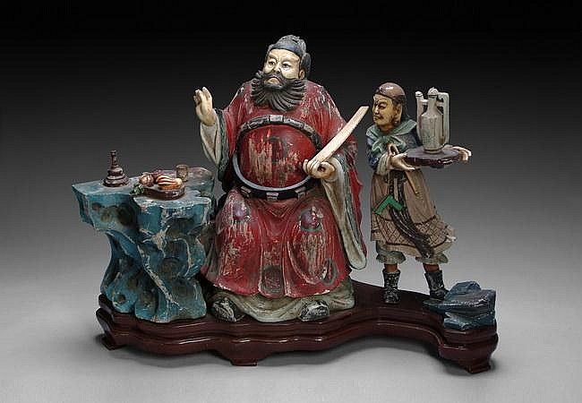 A CHINESE CARVED WOOD AND IVORY FIGURAL GROUP