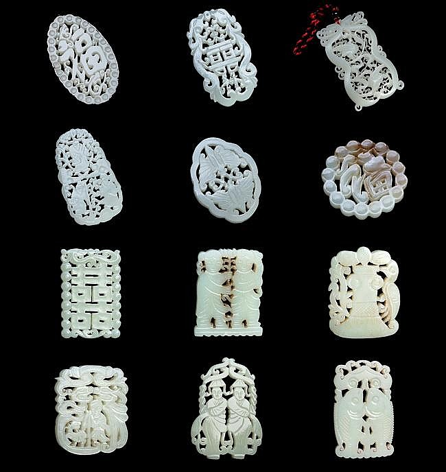 A GROUP OF TWELVE (12) CHINESE CARVED JADE ORNAMENTS
