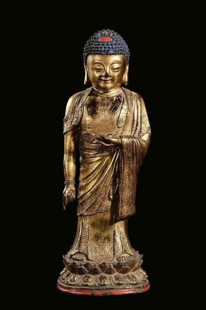 A large gilt-bronze standing Buddha, China, Ming