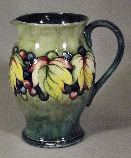 A Moorcroft pottery bulbous shaped water jug, tube