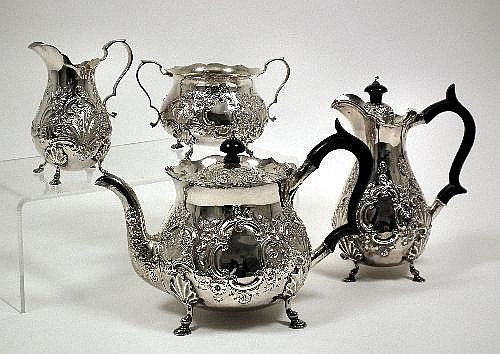 A late Victorian silver four piece tea service,