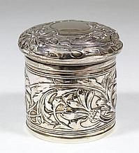 An Edward VII silver cylindrical box and cover the whole cast with flowers