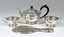 A George V silver three piece tea service the circular bodies with bead mounts