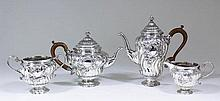 An Edward VII silver four piece tea and coffee service in the manner of Paul De Lamerie (1688-1751)