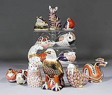 Thirteen Royal Crown Derby bone china paperweights modelled as animals