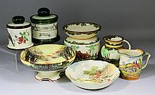 Seven pieces of Royal Doulton printed and coloured pottery