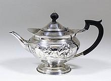 An Edward VII silver bachelor's circular teapot embossed with flowers