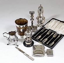 An Edward VII silver pillar candlestick with leaf castings