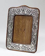 An Edward VII silver rectangular photograph frame of Art Nouveau design