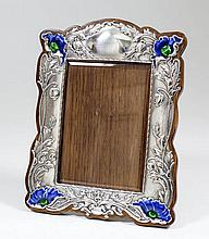 An Edward VII silver rectangular photograph frame of Art Nouveau design and of shaped outline