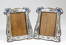 A pair of Edward VII silver rectangular photograph frames of Art Nouveau design