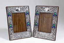 A matched pair of Edward VII silver rectangular photograph frames of Art Nouveau design