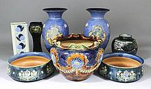 A pair of Royal Doulton blue glazed and moulded stoneware vases