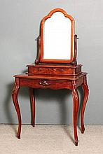 A 19th Century French mahogany dressing table with shaped mirror and raised centre platform