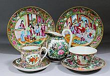 A pair of Chinese Cantonese porcelain circular plates enamelled in colours with figures at various pursuits