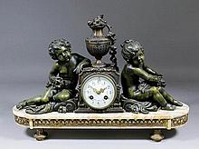A late 19th Century French bronzed spelter and white veined marble mantel clock
