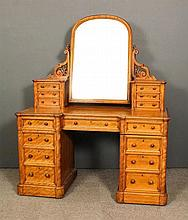 A Victorian satin walnut kneehole dressing table by James Winter & Sons