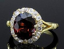 A modern 18ct gold mounted red spinel and diamond