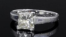 A modern platinum mounted diamond solitaire ring,