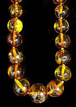 An early 20th Century amber necklace, the