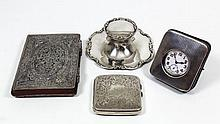 An Edward VII silver capstan pattern inkwell with