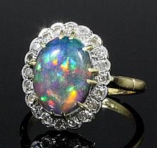 A modern 18ct gold mounted black opal and diamond