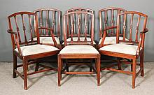A set of six George III mahogany dining chairs